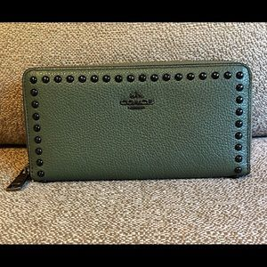Olive green accordion style Coach wallet.